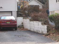 leaning retaining wall safety hazard
